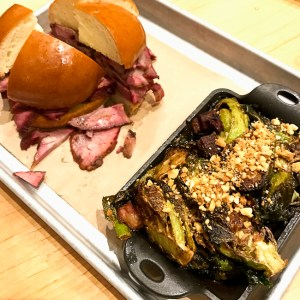 Smoked Brisket Sandwich and Brussels Sprouts with Tasso Ham and Peanuts