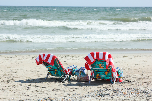 Colorful beach chairs next to the shore