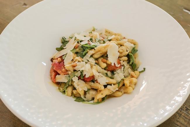Cavatelli pasta with kale pesto cream and roasted tomatoes