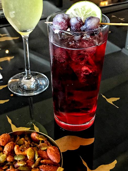 Purple Rain cocktail garnished with frozen grapes at Montage Laguna Beach