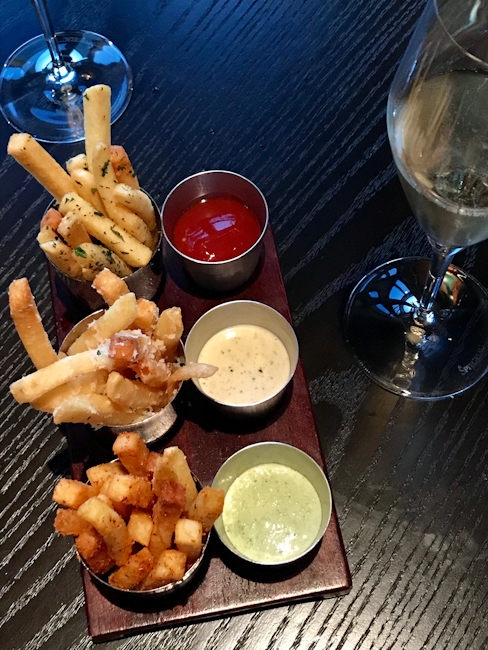 Trio of french fries with dipping sauces