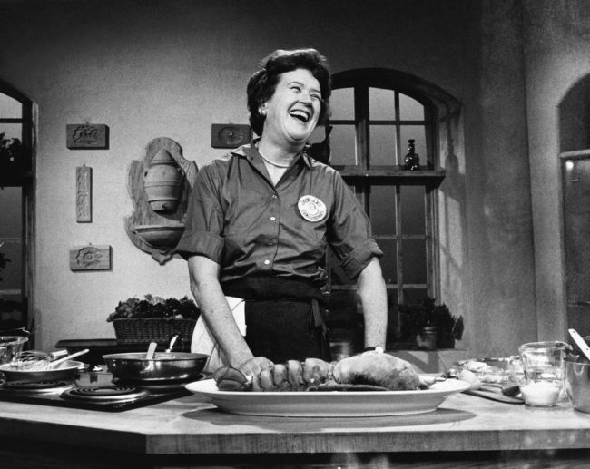 Julia Child laughing in the kitchen
