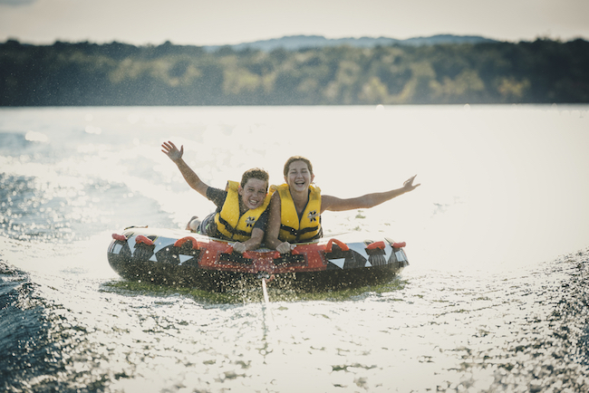 Girls tubing on Table Rock Lake, outdoor activities in Branson