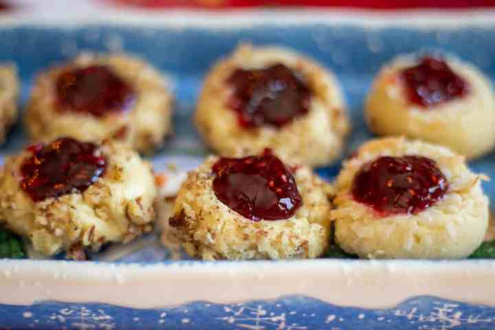 shortbread jam thumbprint cookies on blue and white plate