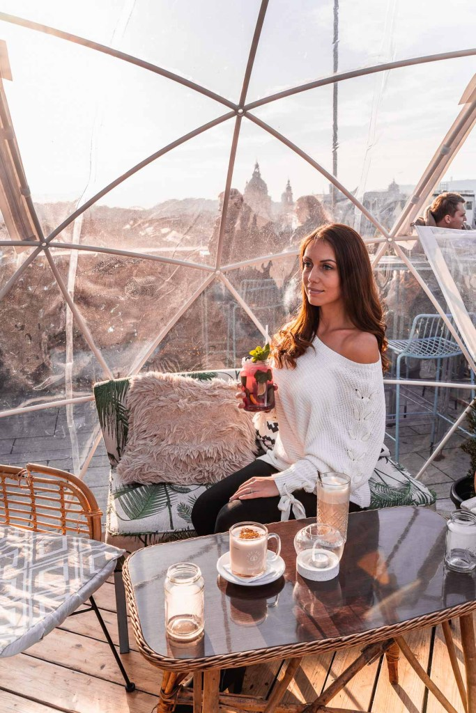 Girl sitting in one of the igloos at the 360 Bar Budapest