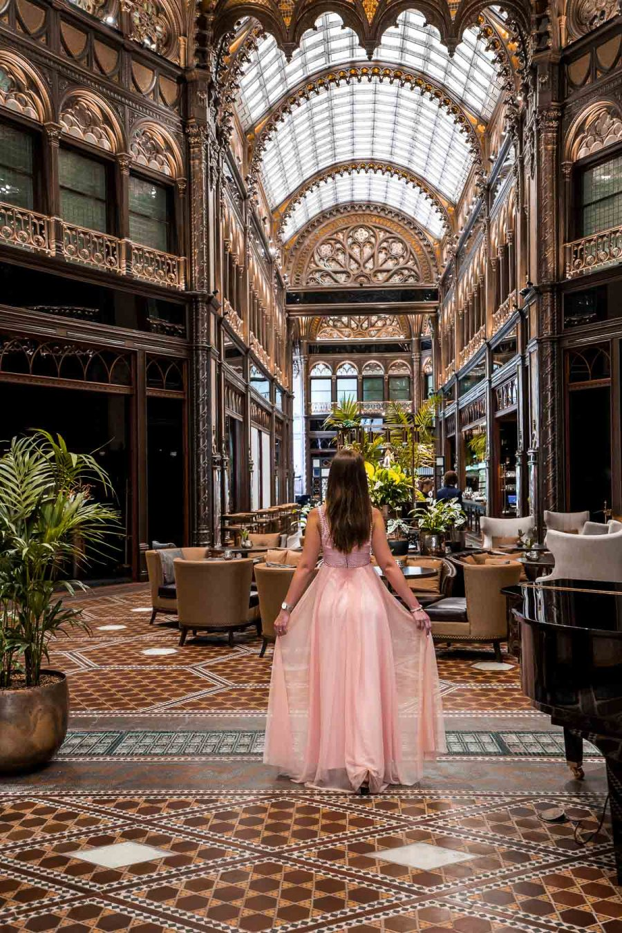 Girl in a pink dress standing in the Paris Court in Budapest