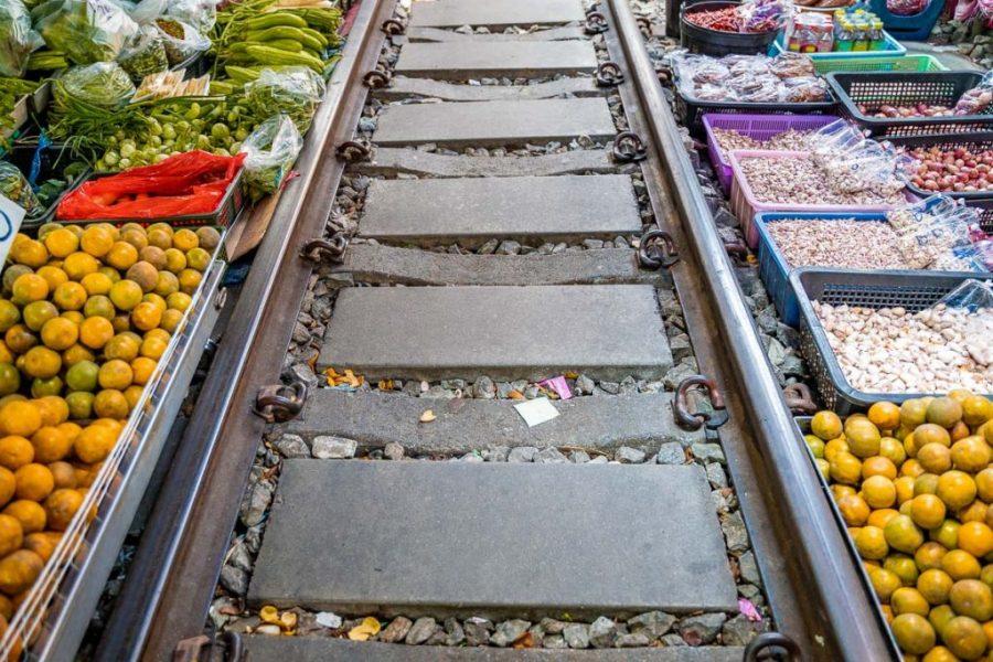 Goods next to the railway at the Maeklong Railway Market