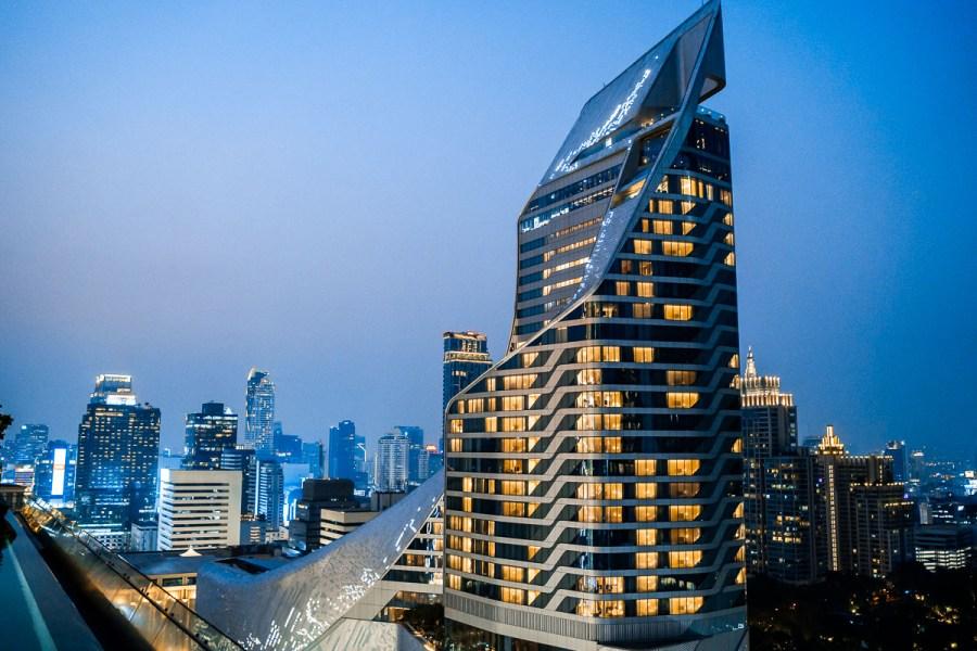 View of the Bangkok skyline at night from the infinity pool at the Okura Prestige Bangkok
