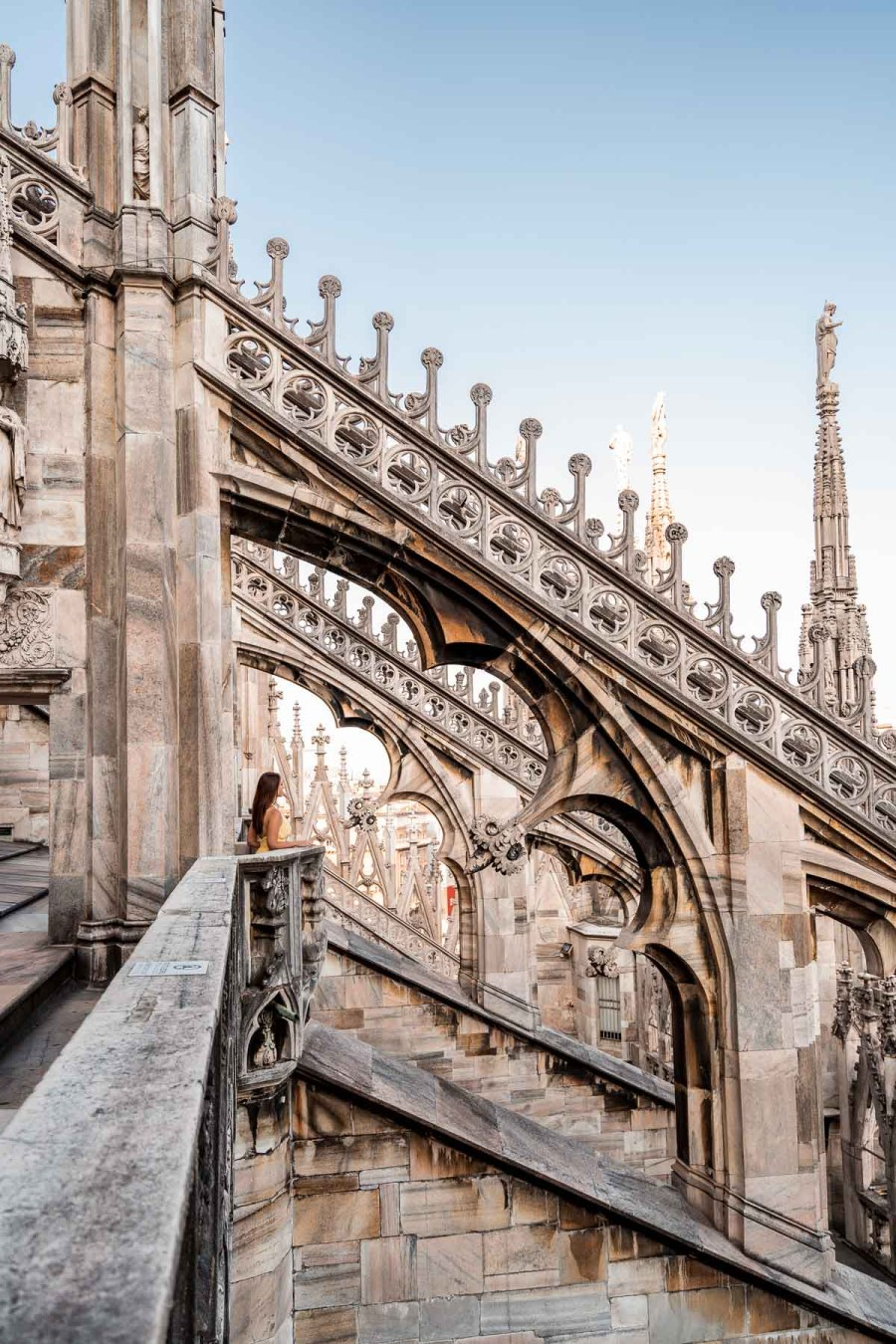 Girl standing on the roof of the Duomo di Milano in Italy