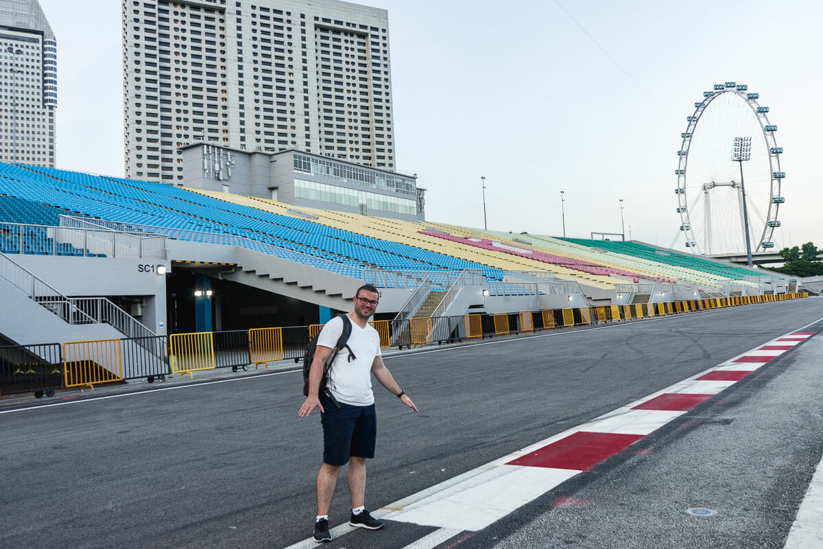 Guy in a white shirt standing on the street at Marina Bay Circuit in Singapore