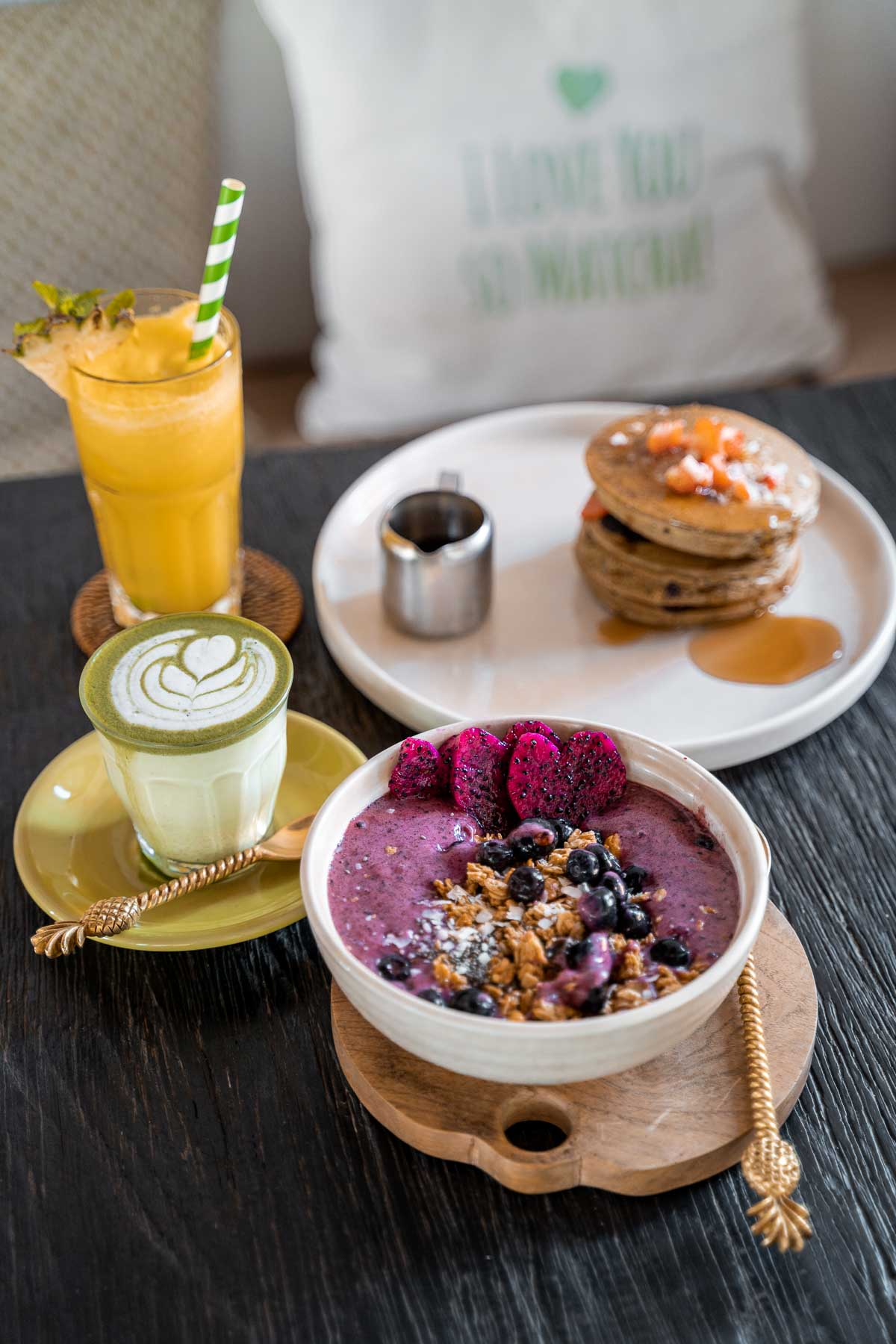Breakfast with smoothie bowl and pancakes at Matcha Cafe in Canggu, Bali