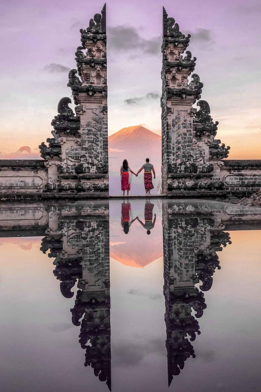 Girl and a boy standing at the Gates of Heaven at Pura Lempuyang in Bali