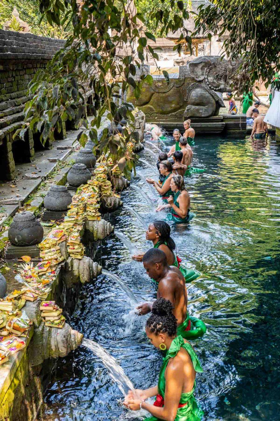 Cleansing ritual at Pura Tirta Empul Temple, Bali