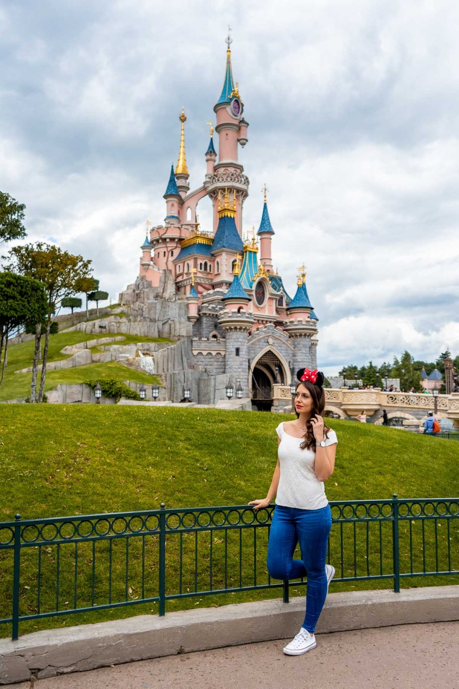 Girl standing in front of Sleeping Beauty's Castle in Disneyland Paris, which is one of the best Paris Instagram spots