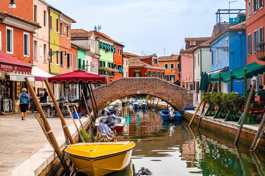 Colorful houses along the canal in Burano, Italy