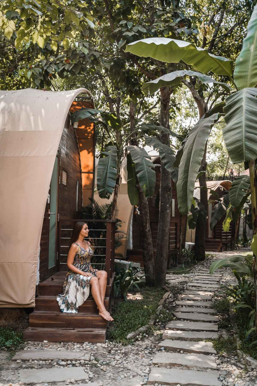 Girl sitting in front of one of the Jungloo Tents at Templation Siem Reap