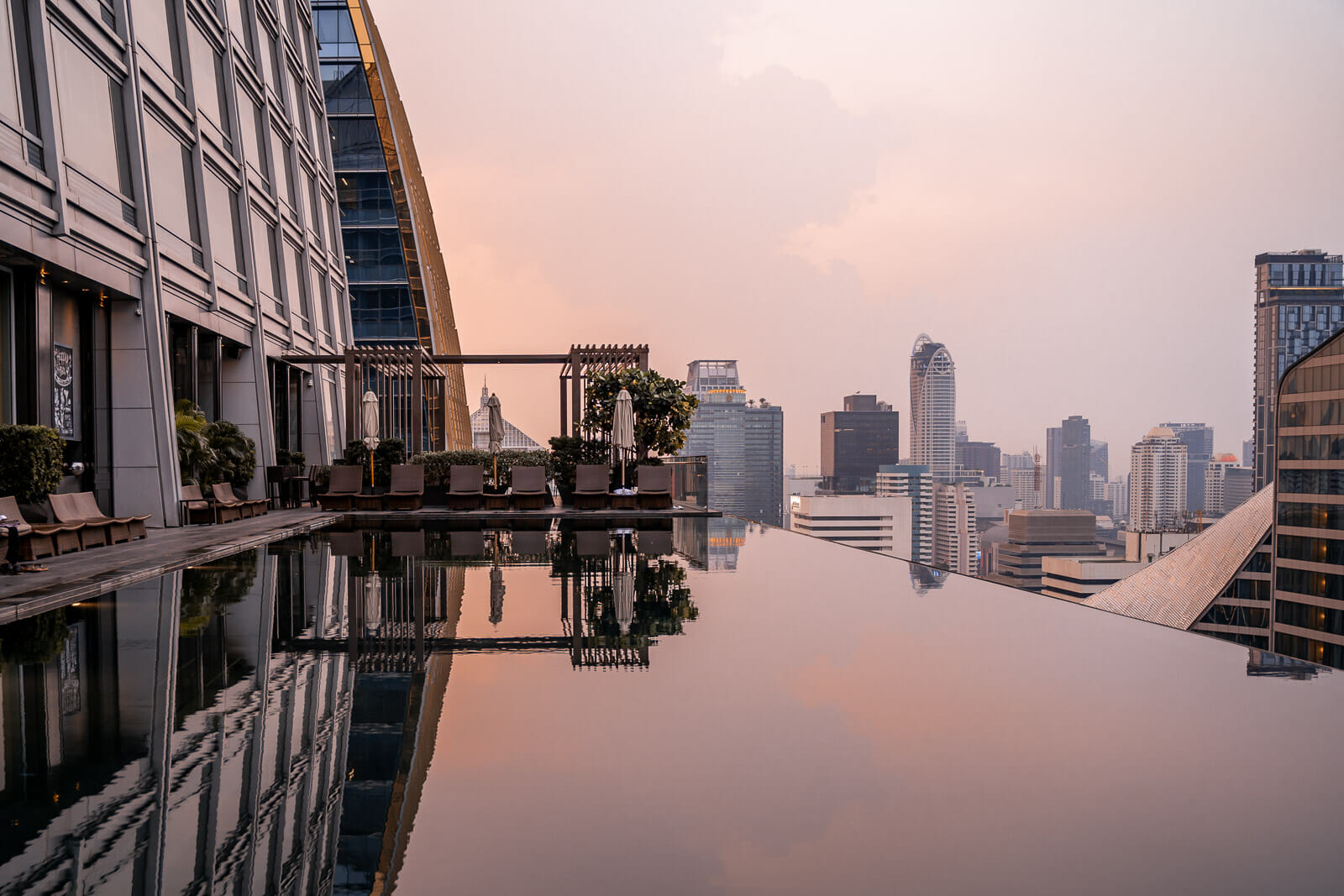 Perfect reflection of the sunset and the Bangkok skyline in the pool at Okura Prestige Bangkok