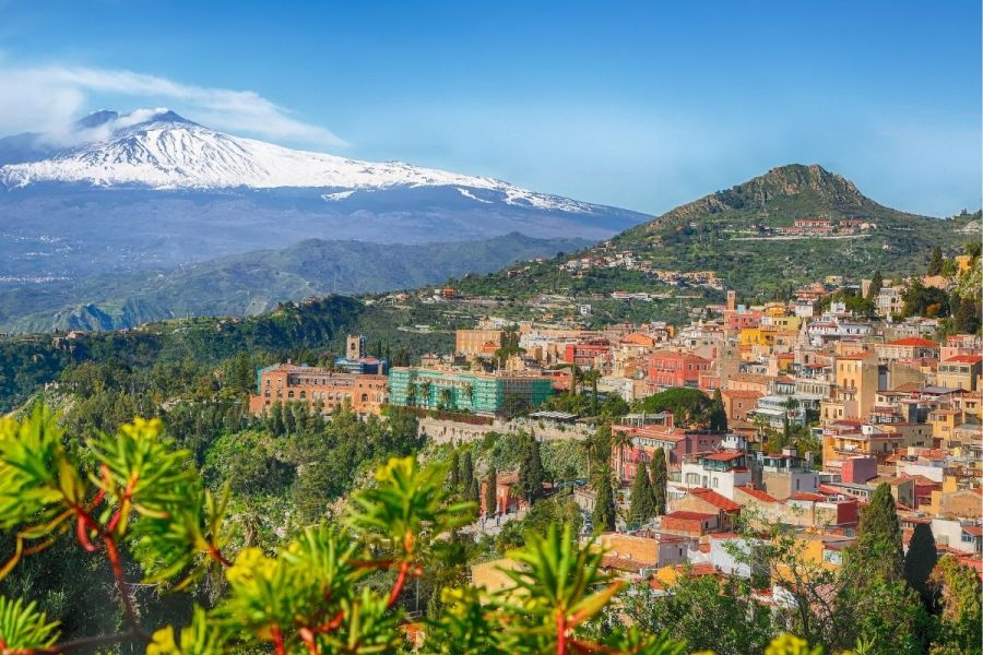 Panoramic view of Taormina and the Etna volcano in Sicily, Italy