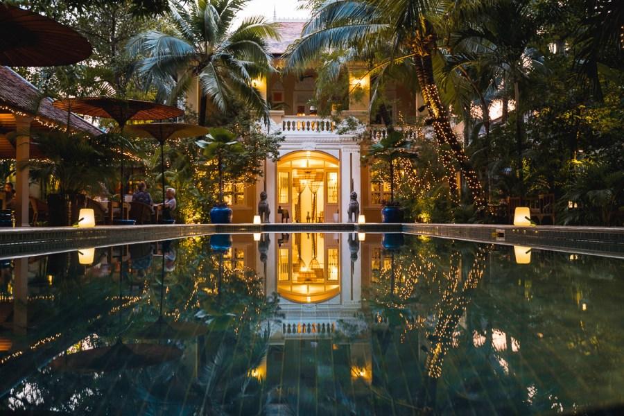 Lush Pool at Pavilion Phnom Penh at night