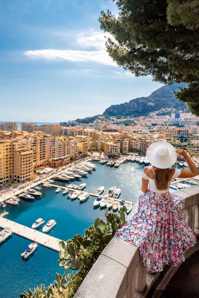 Girl in a floral dress sitting at a viewpoint in Monte Carlo, Monaco