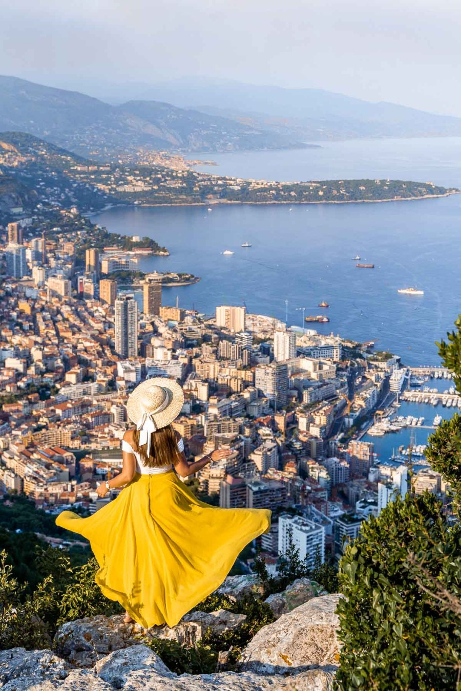 Panoramic view from Tete de Chien with girl in a yellow skirt in the middle