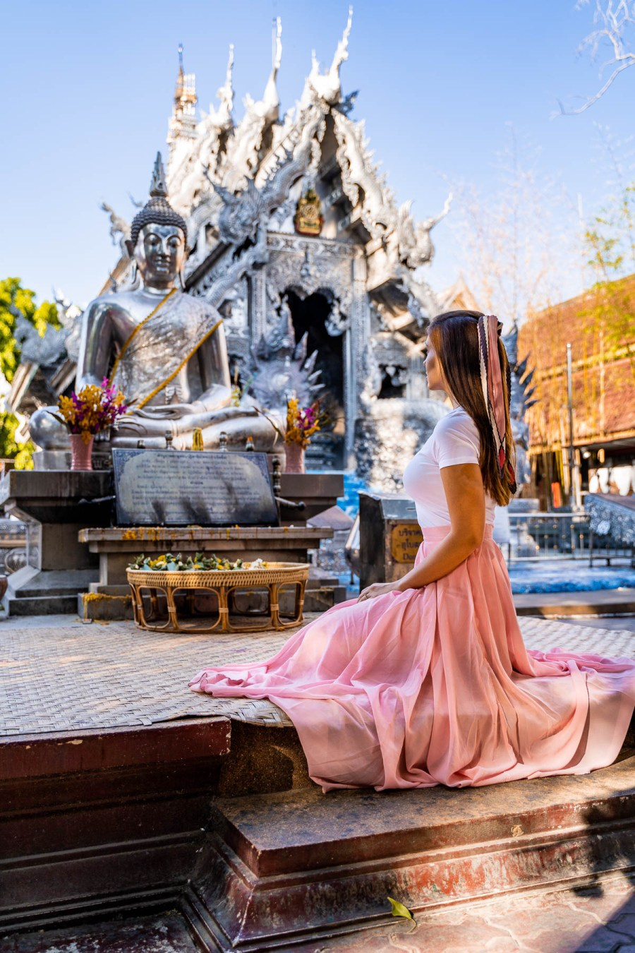 Wat Sri Suphan, the Silver Temple in Chiang Mai, Thailand with girl in a pink skirt in the middle