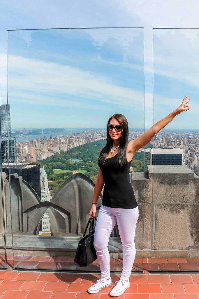 Girl standing on the Top of the Rock with the view of Central Park in the background