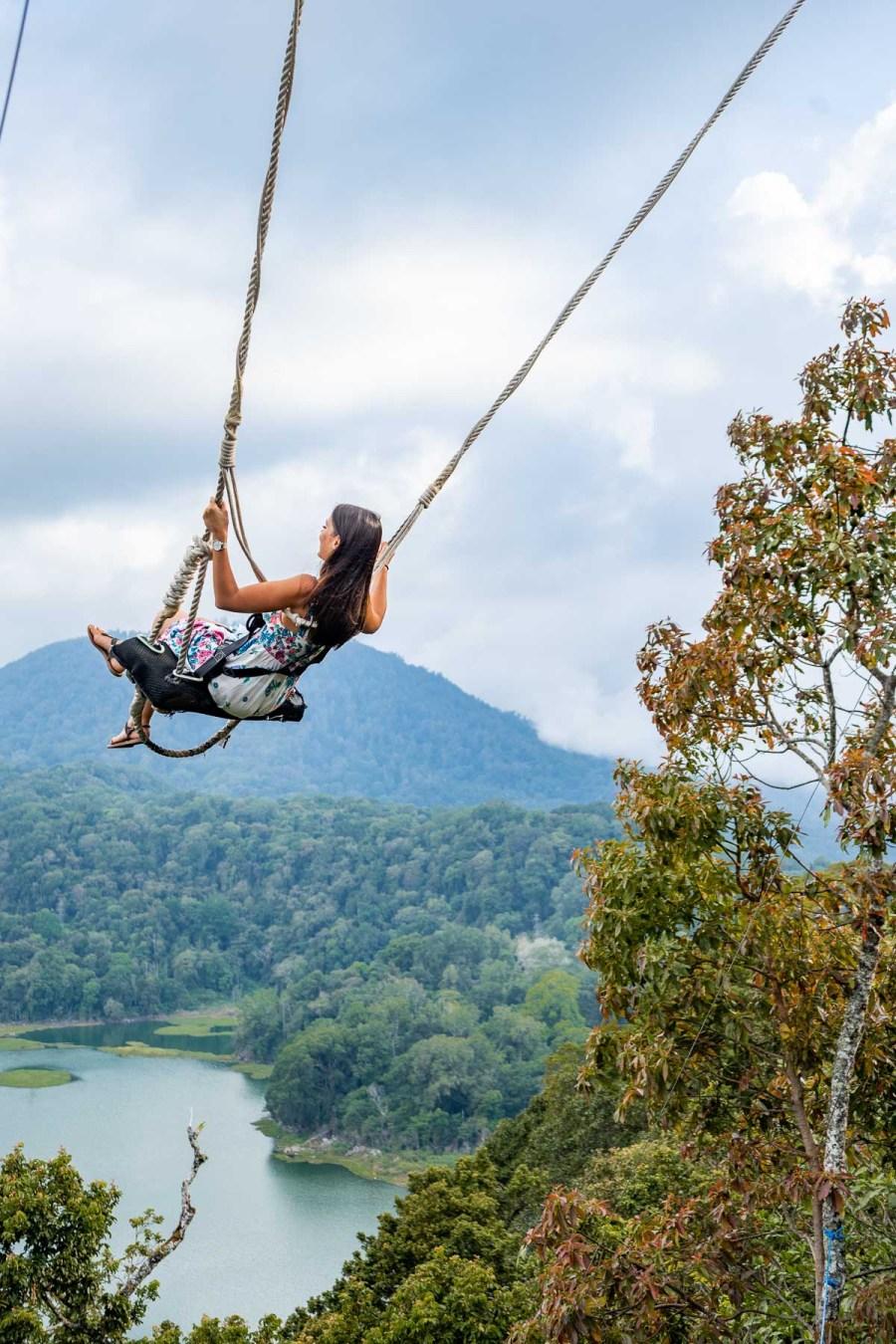 Girl swinging at Wanagiri Hidden Hills in Bali
