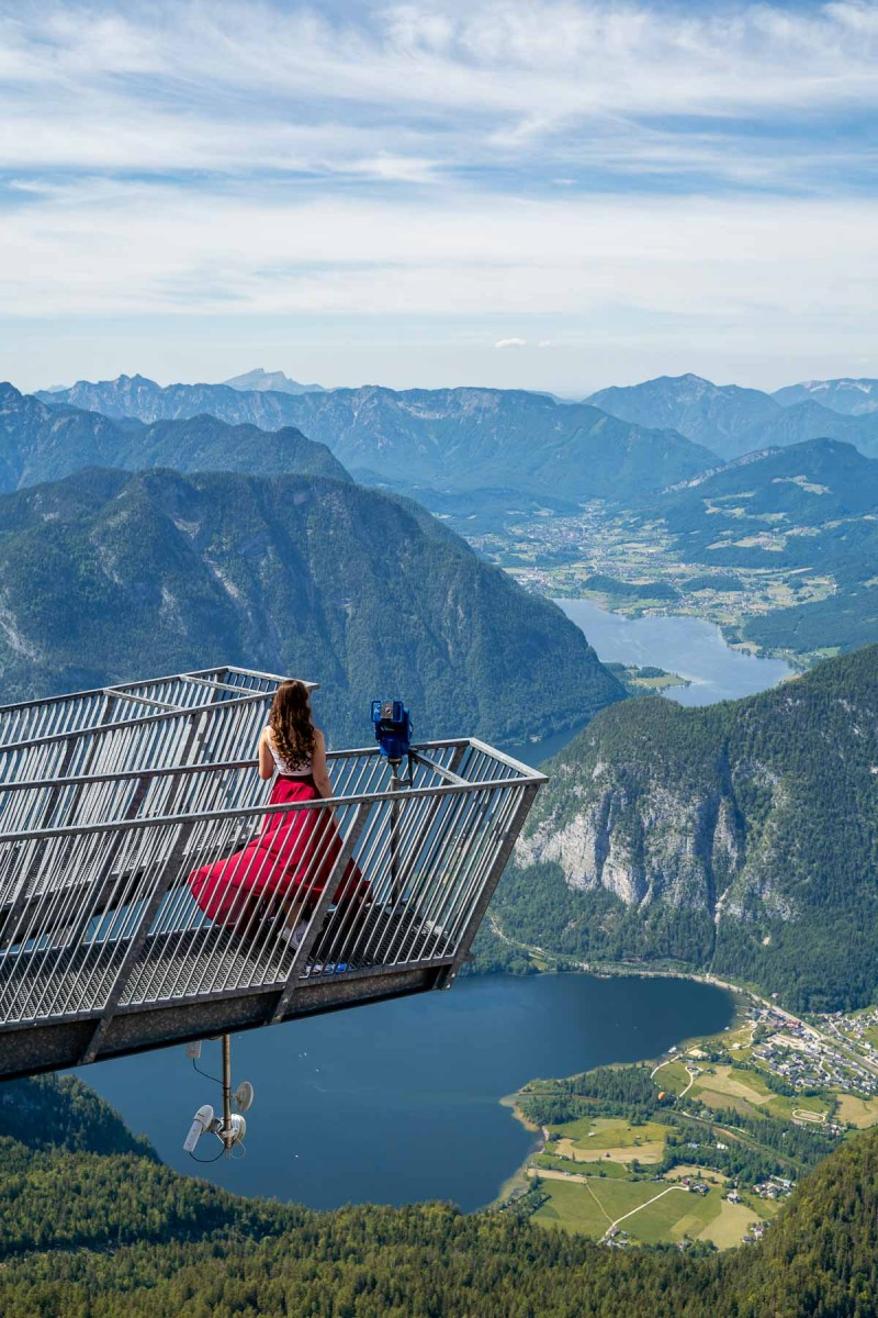 Girl in a red skirt standing on the 5 Fingers Viewing Platform in Austria