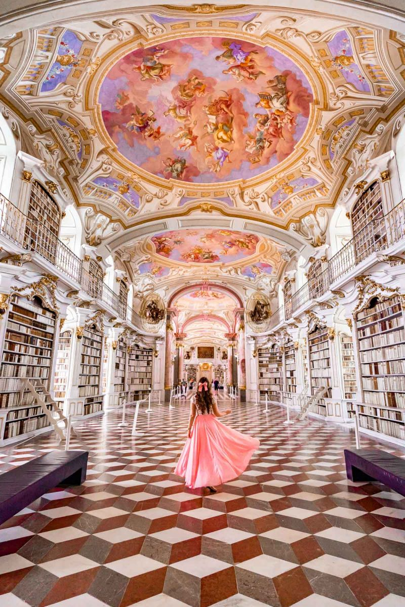Girl in a pink skirt inside Admont Abbey Library, Austria