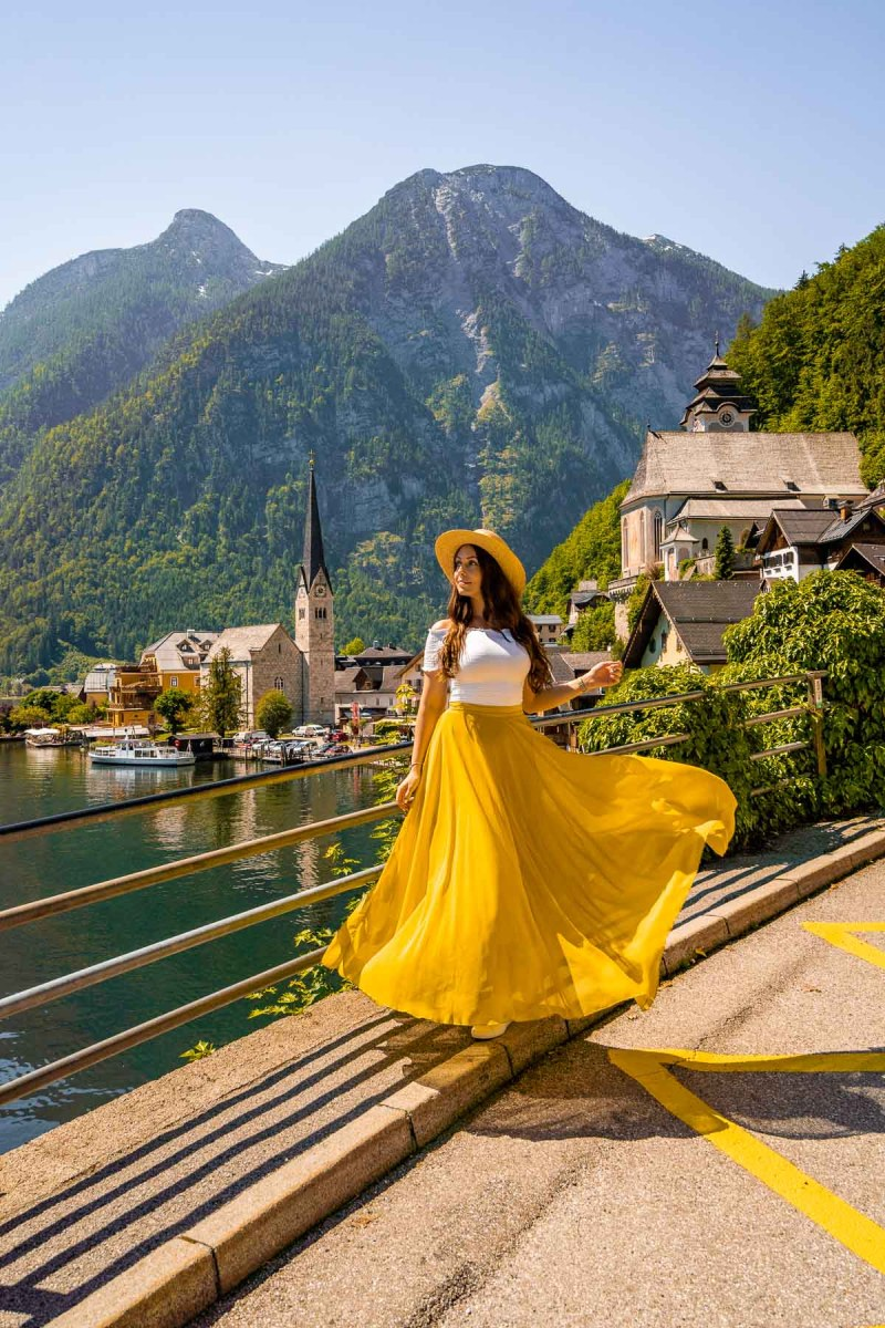 Girl in a yellow skirt at Hallstatt Classic Postcard Viewpoint