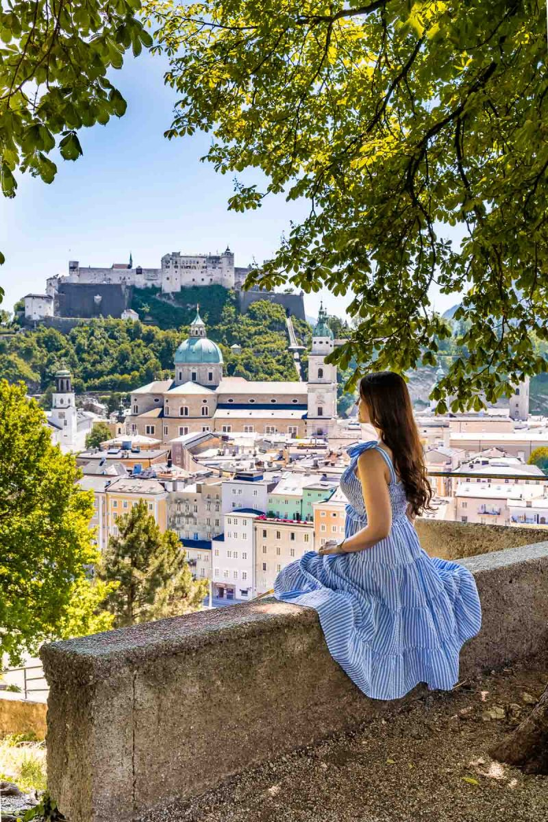 Panoramic view of Salzburg from the Kapuzinerkloster viewpoint with girl in a blue dress