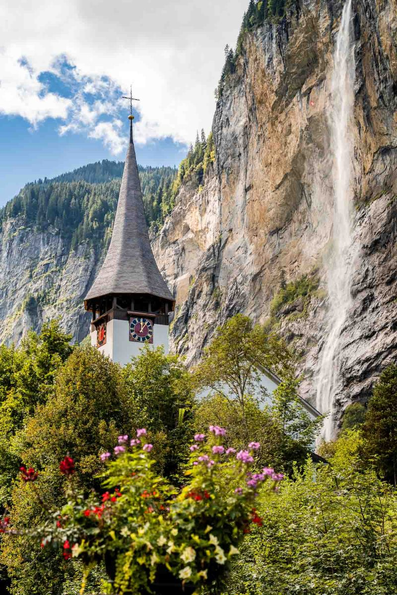 Church and waterfall in Lauterbrunnen, Switzerland