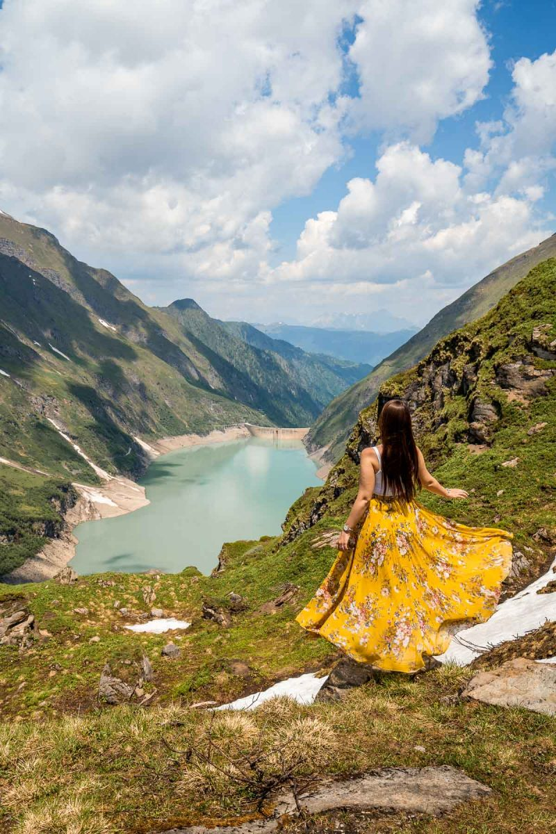 Girl in a yellow dress in front of Stausee Mooserboden, Austria