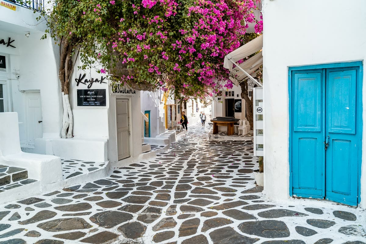 Painted streets with pink bougainvillea in Mykonos