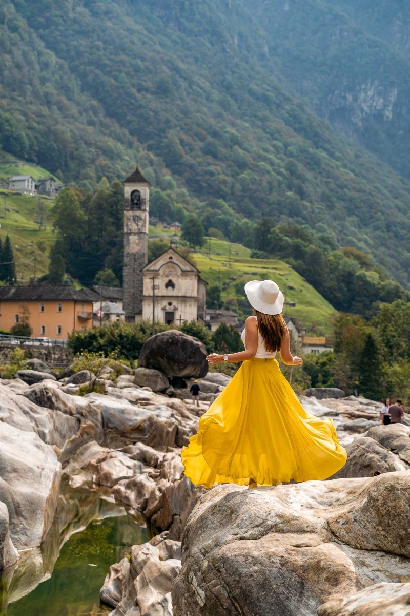 Girl in a yellow dress at Valle Verzasca, Switzerland
