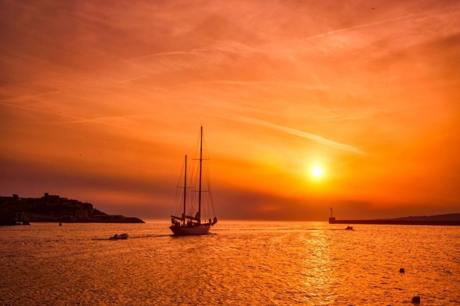 Sailboat at sunset in Marseille, France