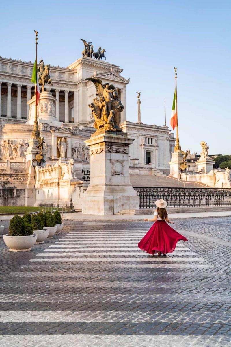 Girl in a red skirt in front of Altare della Patria in Rome, Italy