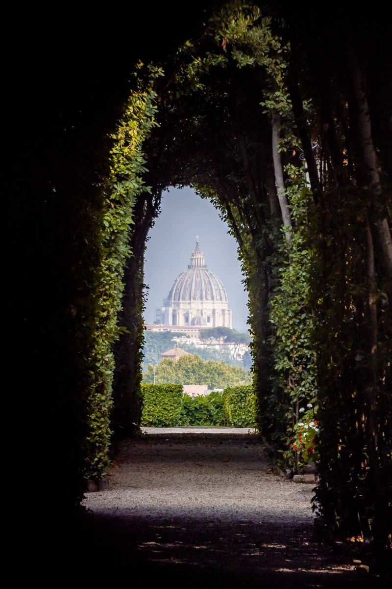 View through the Aventine Keyhole in Rome, Italy