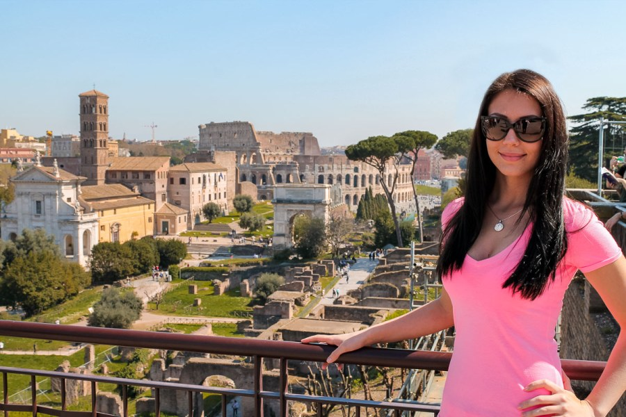 Girl in a pink skirt at the Forum Romanum in Rome, Italy