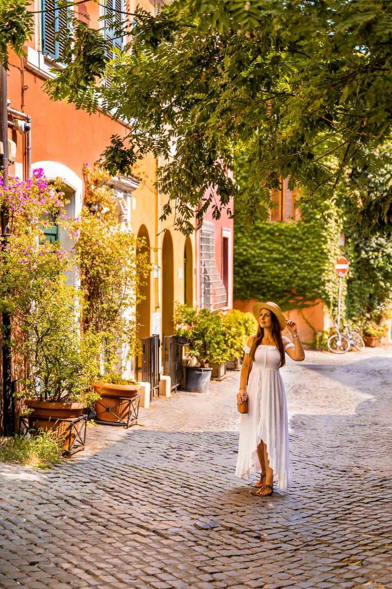 Girl in a white dress in the Trastevere neighborhood in Rome, Italy