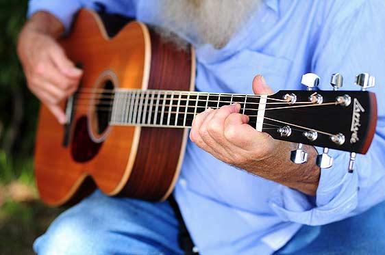 Tobias playing guitar