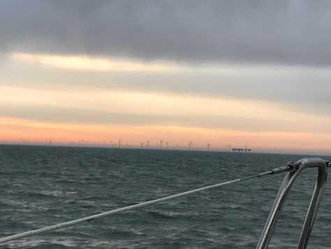 sunrise_sailing_wind_turbines_offshore