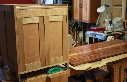 Case with door set in next to the top with its final coat of finish.