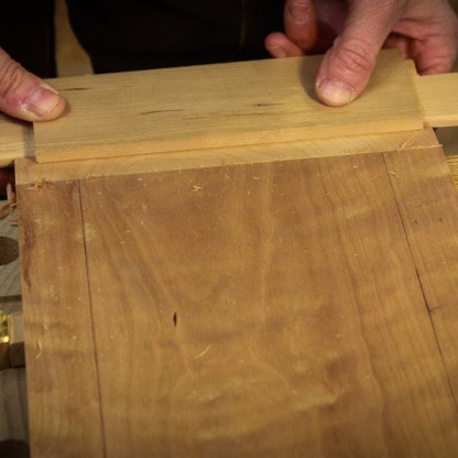 Fit the beveled edges in to the rail and style grooves.