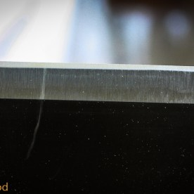 Polished edge after 1000, 5000 and 8000 grit water stones. (it really is polished, the pic just doesn't show it).