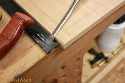 Chamfering the leading edge of the rabbet.