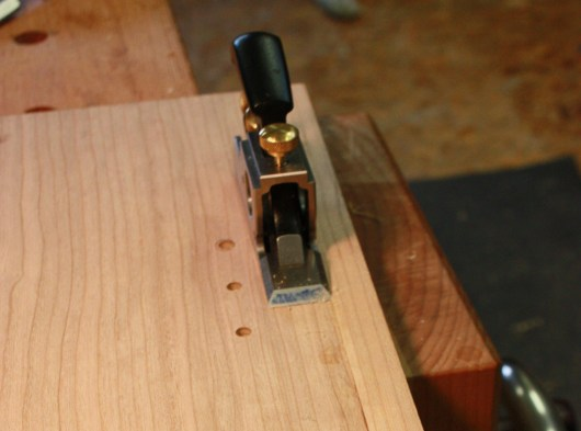 After gluing on the edge banding I used my bull nose plane to clean glue.