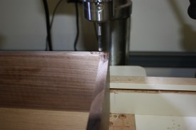 Drilling out the waste for the hinges on the drill press.
