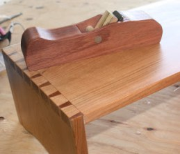 Wooden plane and cherry TV table